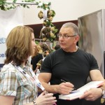 People listen when Chef Robert talks in Easy Ice booth