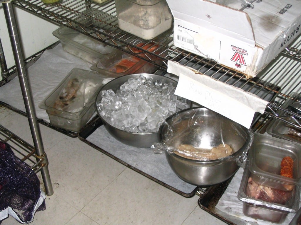 uncovered ice in walk-in is food safety fail